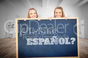 Composite image of close up of young women behind a blank sign