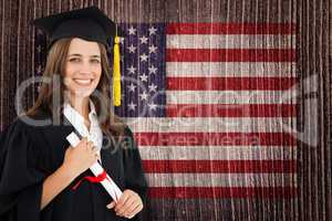 Composite image of a smiling woman with a degree in hand as she