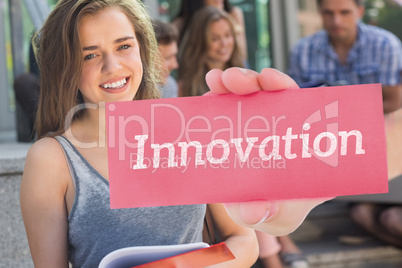 Innovation against pretty student smiling at camera outside