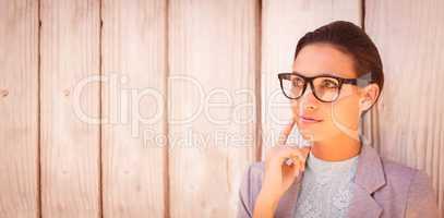 Stylish brunette thinking and smiling
