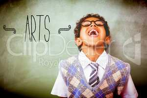 Arts against boy laughing in front of blackboard
