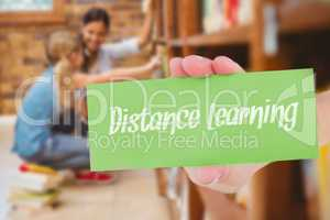 Distance learning against teacher and little girl selecting book