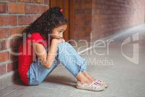 Upset lonely girl sitting by herself