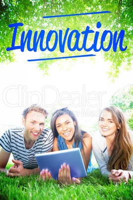Innovation against happy students using tablet pc outside
