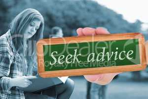Seek advice against pretty student studying outside on campus