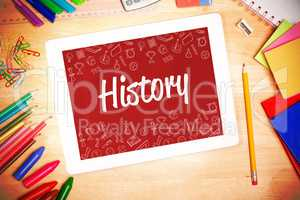 History against students desk with tablet pc