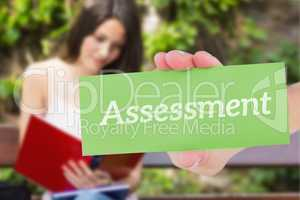 Assessment against pretty student studying outside on campus