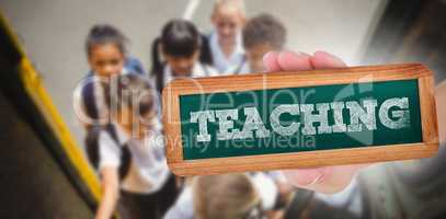 Teaching against cute schoolchildren getting on school bus