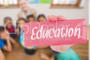 Education against cute pupils and teacher in classroom with glob