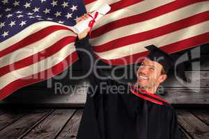 Composite image of happy attractive boy celebrating his graduati