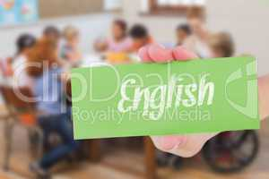 English against pretty teacher helping pupils in classroom