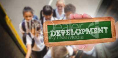 Development against cute schoolchildren getting on school bus