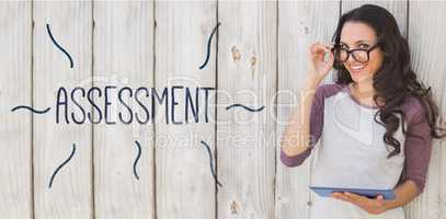 Assessment against pretty brunette using a tablet pc