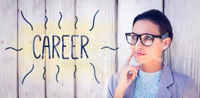Career against stylish brunette thinking and smiling