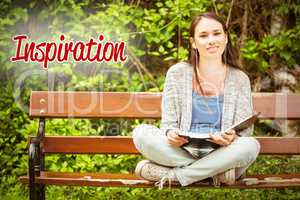Inspiration against smiling student sitting on bench listening m