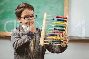 Pupil dressed up as teacher holding abacus