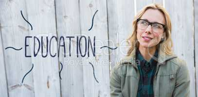 Education against blonde in glasses posing and thinking