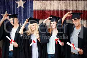 Composite image of group of teenagers celebrating after graduati