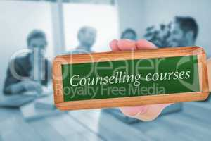 Counselling courses against group of colleagues reading books