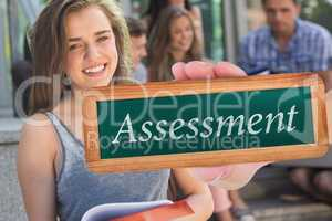 Assessment against pretty student smiling at camera outside
