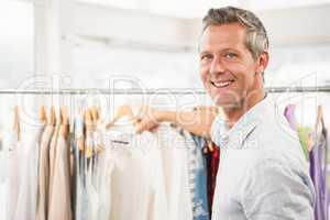 Smiling man browsing clothes