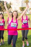 Cheering blonde winning breast cancer marathon