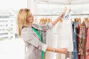 Smiling woman browsing clothes