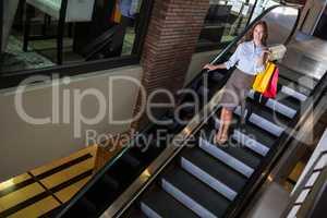 Pretty woman on the escalator