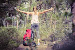 Carefree blonde hiker with arms outstretched