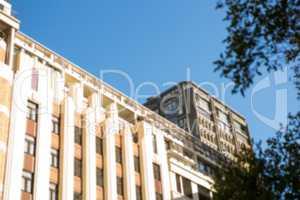 Blue sky over large building
