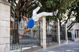 Extreme athlete jumping in front of building