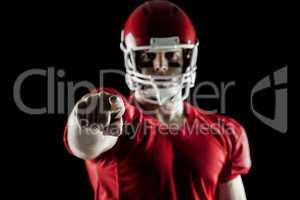 American football player pointing at camera