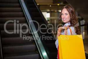 Pretty woman by the escalator