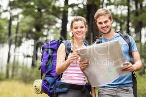 Portrait of a young happy hikers couple