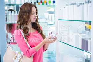 Pretty woman shopping for cosmetics
