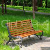 park bench and green lawn