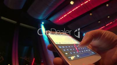 Typing sms at nightclub