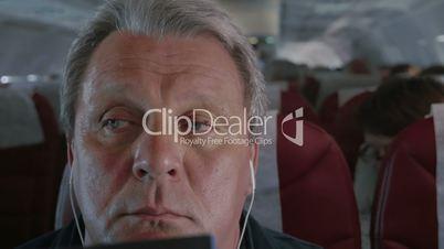 Man in Plane Falling Asleep