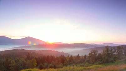 Bright Sunrise and Fog in the Valleys. Time Lapse