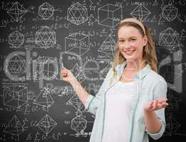 Composite image of teacher explaining maths in blackboard
