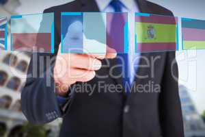 Composite image of businessman pointing his finger at camera