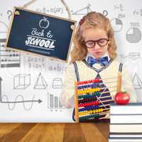 Composite image of pupil holding abacus at elementary school