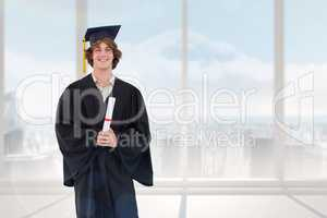 Composite image of smiling student in graduate robe