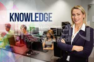 Knowledge against computer teacher smiling at camera with arms c
