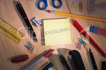 Excellent! against students table with school supplies