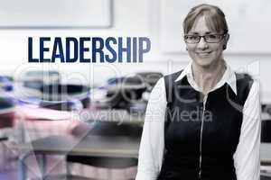 Leadership against smiling female teacher in the class room