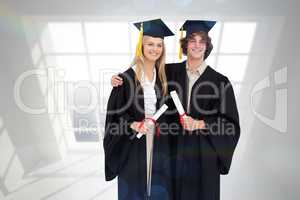 Composite image of two students in graduate robe shoulder to sho