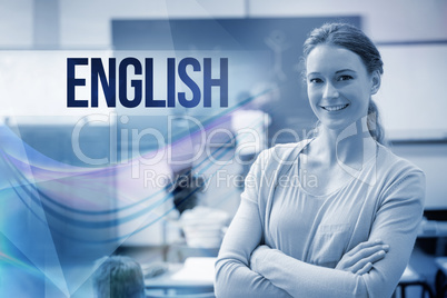 English against pretty teacher smiling at camera at back of clas