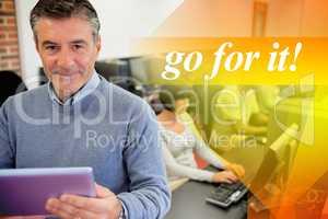 Go for it! against teacher holding a tablet pc