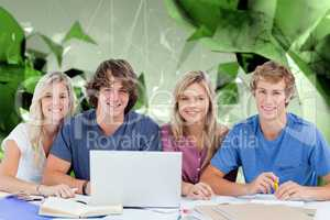 Composite image of a group of students with a laptop look into t